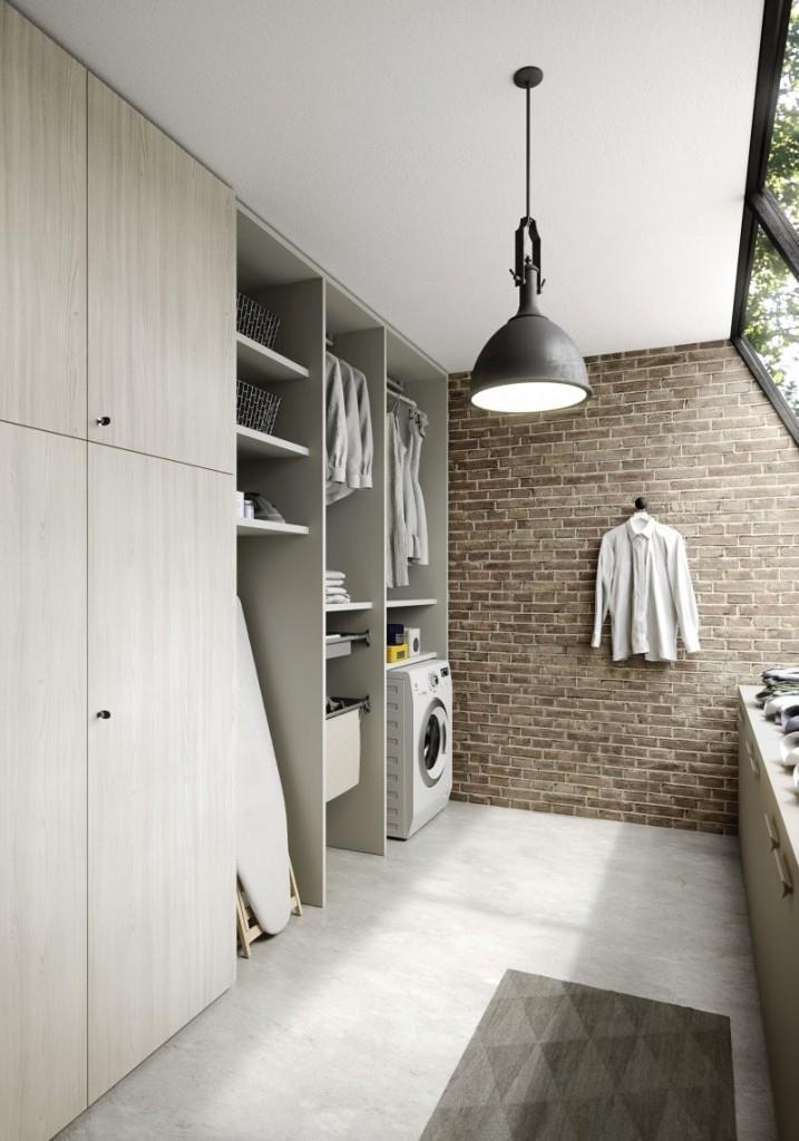 lavanderia in stile Urban chic con tappezzeria effetto mattoni.